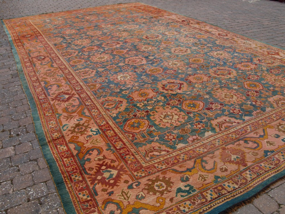 exceptional antique turkish oushak carpet of large size and outstanding colour circa 1880