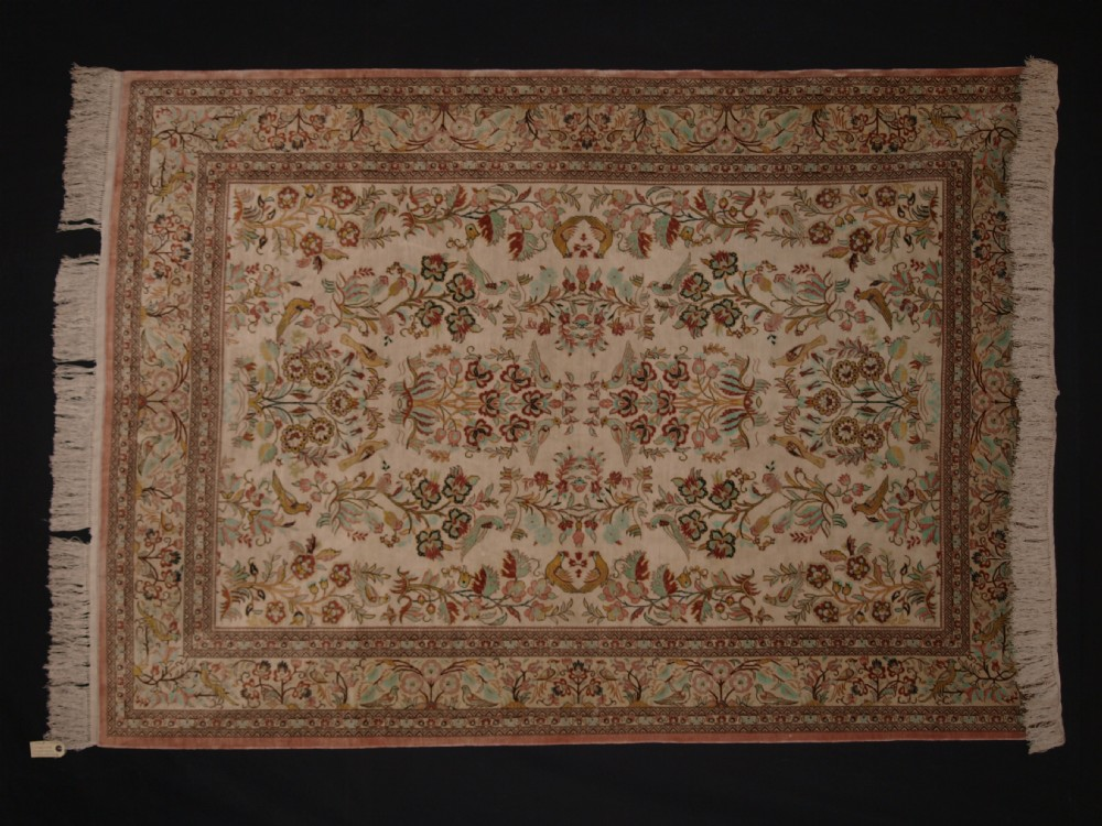 outstanding persian qum silk rug with garden design one of a pair about 50 years old