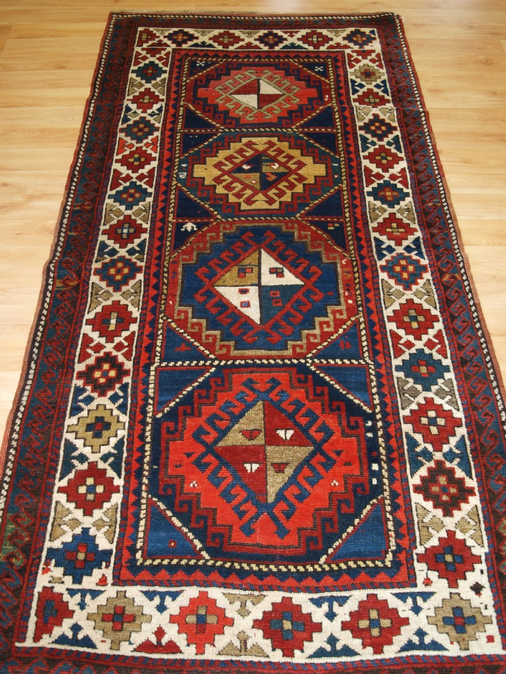 antique caucasian kazak long rug superb colour and design circa 1900