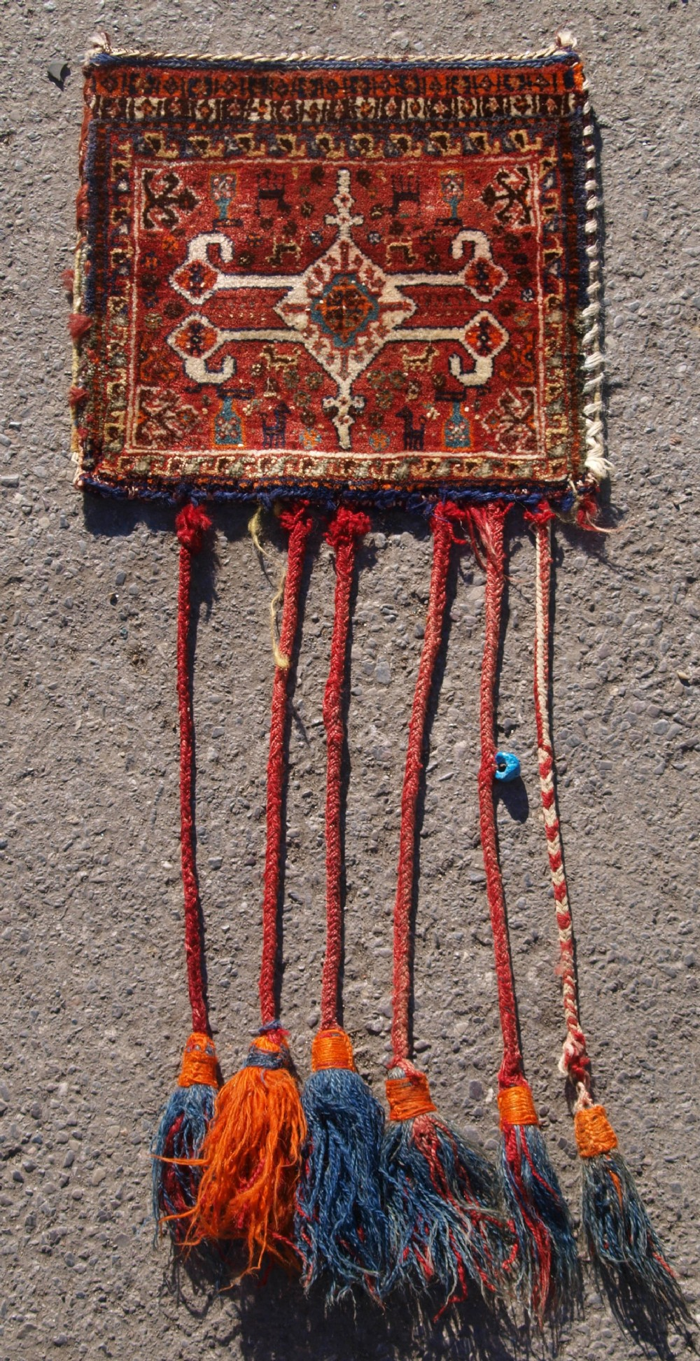 antique south west persian qashqai chanteh with plain weave back and tassels circa 190020