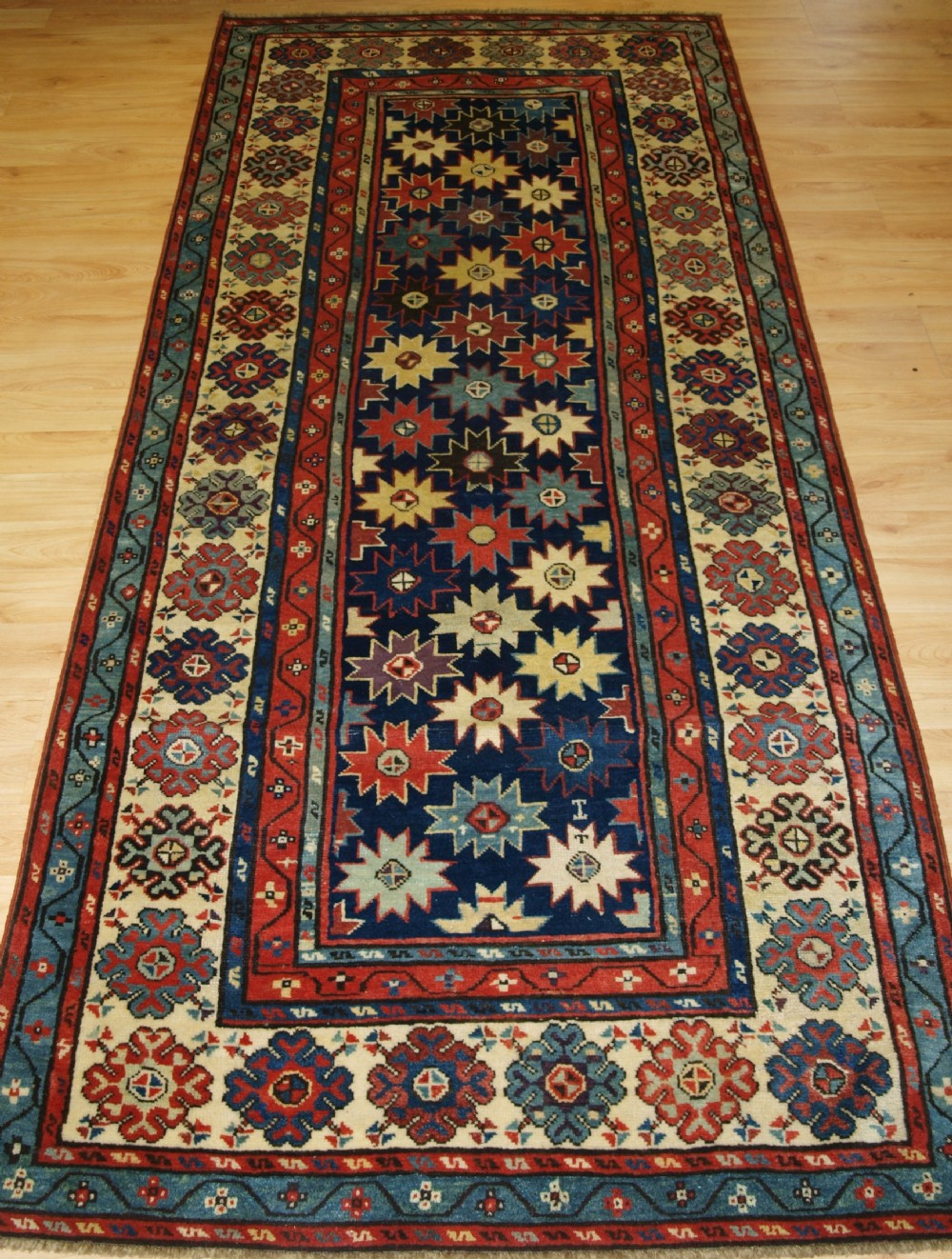 antique caucasian talish long rug with star design superb colours mid 19th century