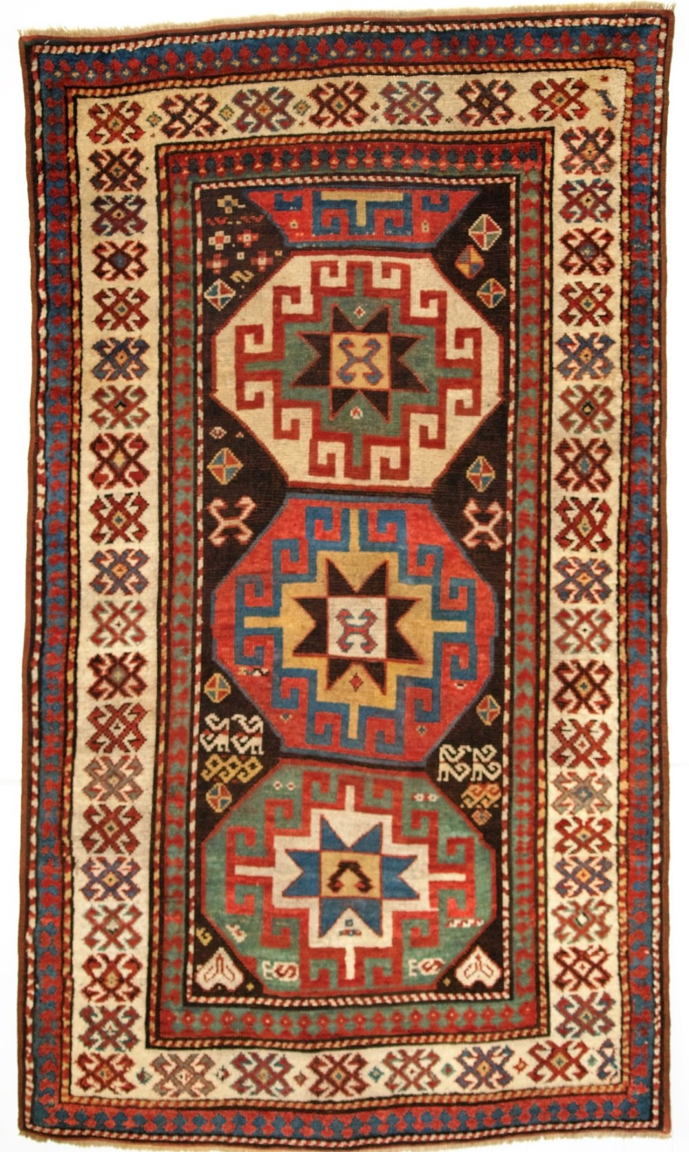 antique caucasian kazak rug with memlinc guls within octagons superb colour 2nd half 19th century