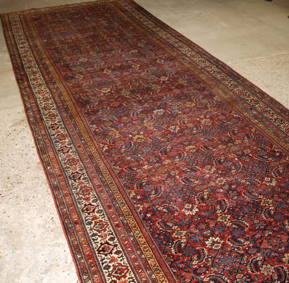 antique north persian faraghan kelleh corridor carpet of exceptionally large size and fine weave late 19th century