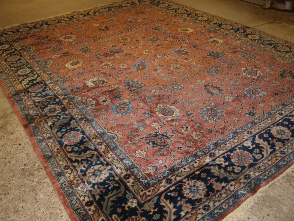 old turkish isparta carpet classic floral design light red ground with pastel colours circa 1920