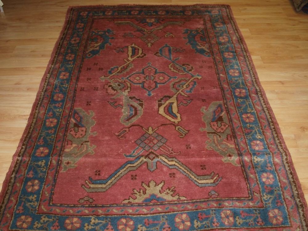 old turkish oushak rug with soft pastel colours very soft wool circa 1920