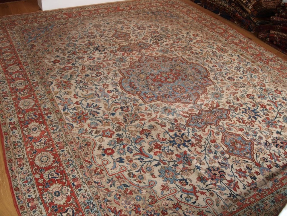 antique persian tabriz carpet ivory ground with soft pastel colours circa 190020