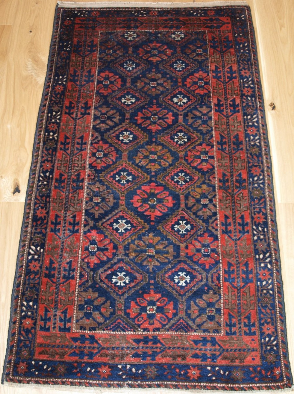 old baluch rug with lattice design interesting border circa 1920