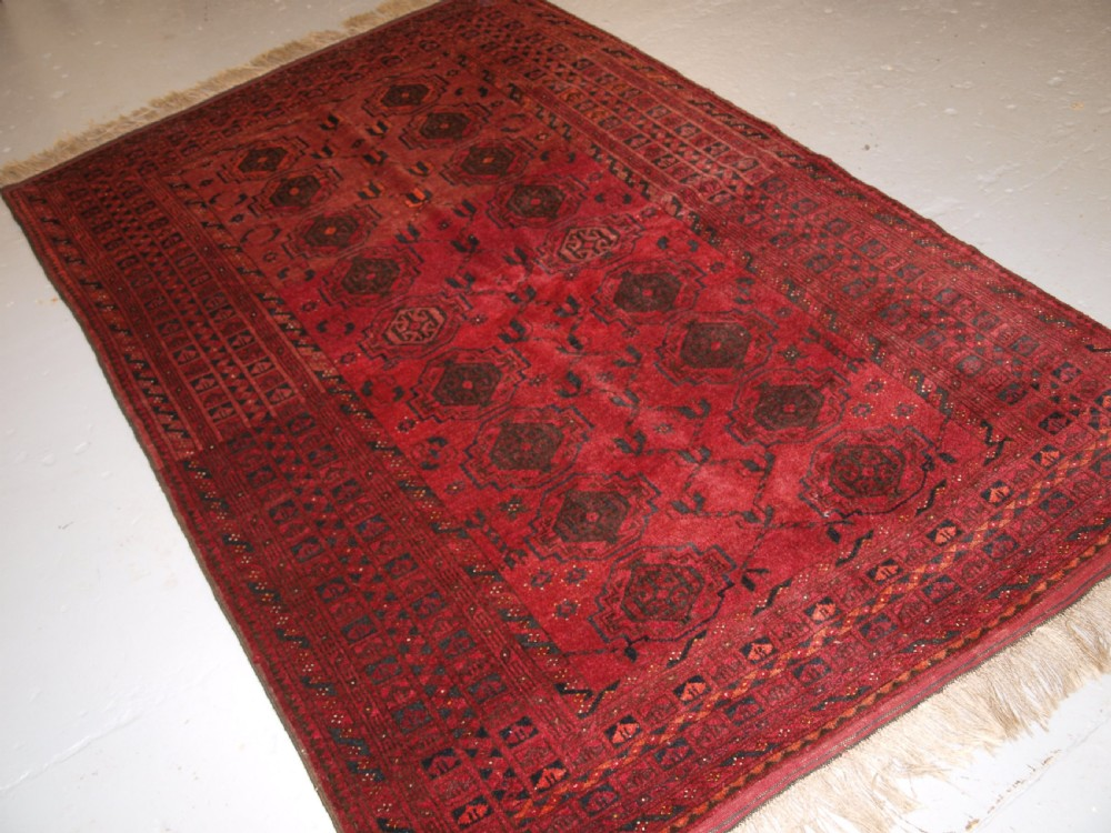 old afghan village rug with turkmen chuval gul design plum red colour circa 1920