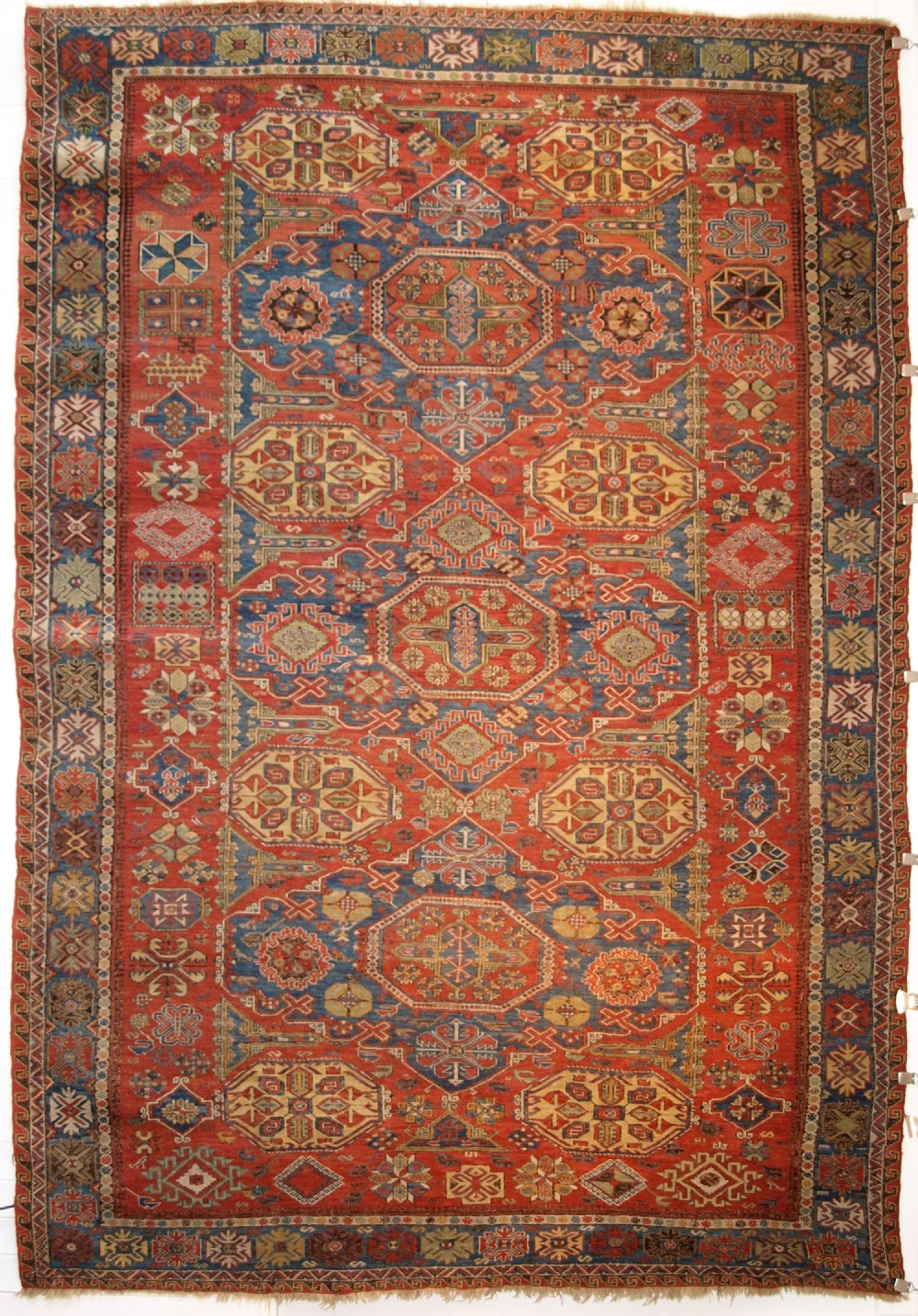antique caucasian three medallion soumak carpet of rare design superb colour circa 1880