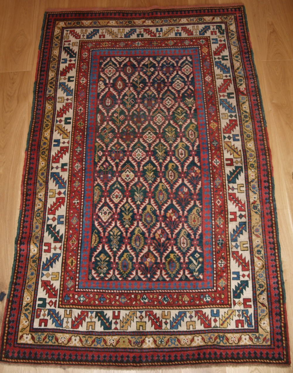 antique caucasian daghestan rug with scarce green ground lattice design circa 1880