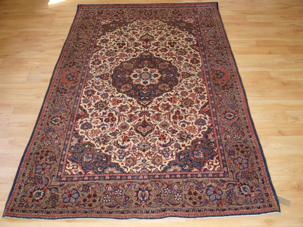 old persian tabriz rug of traditional floral medallion design circa 192030