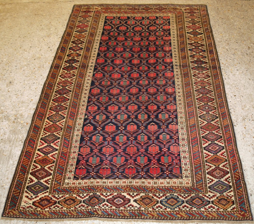 antique caucasian shirvan rug with lattice design filled with tulips late 19th century