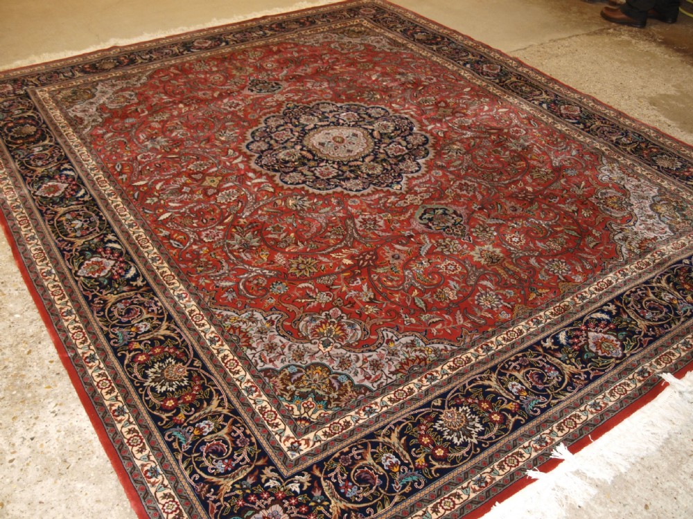 old persian isfahan carpet of fine weave traditional medallion design about 30 years old