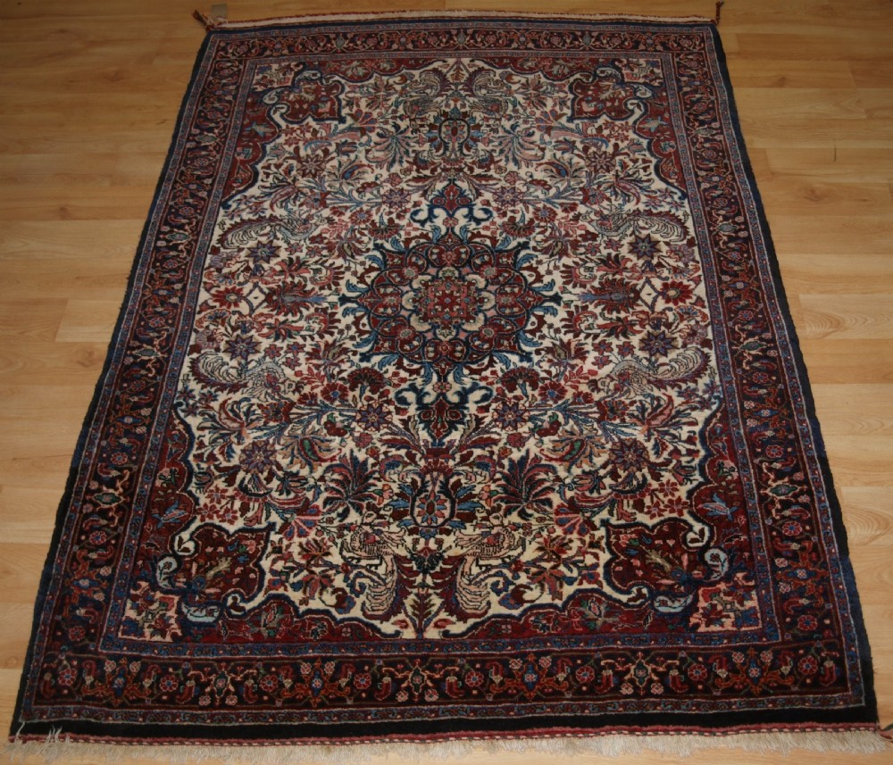 old persian bijar rug ivory ground with floral design circa 192030