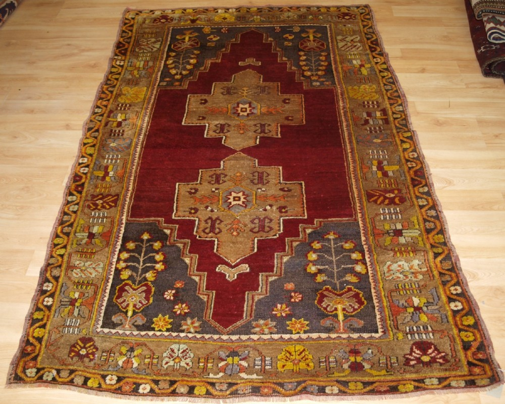 antique turkish maden region rug double medallion red ground circa 1900