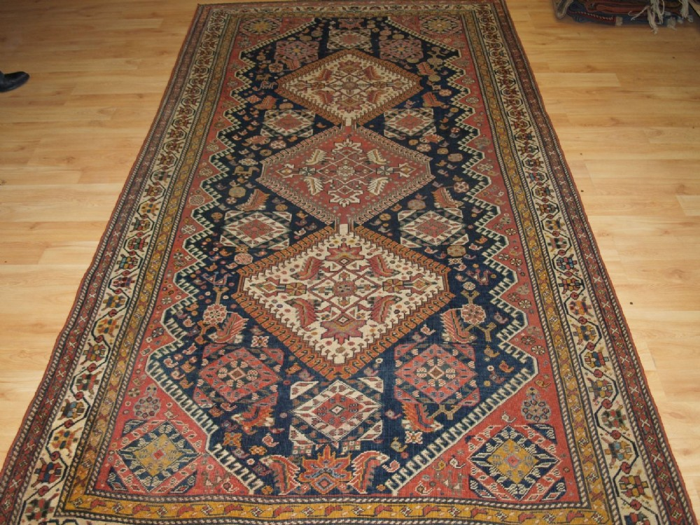 antique tribal qashqai rug triple medallion with large scale heratti design circa 1900