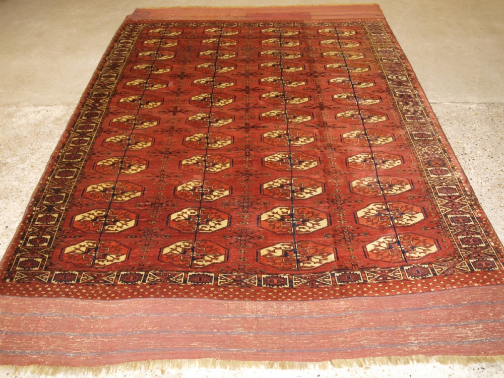 antique tekke turkmen main carpet with rare octagonal guls mid 19th century