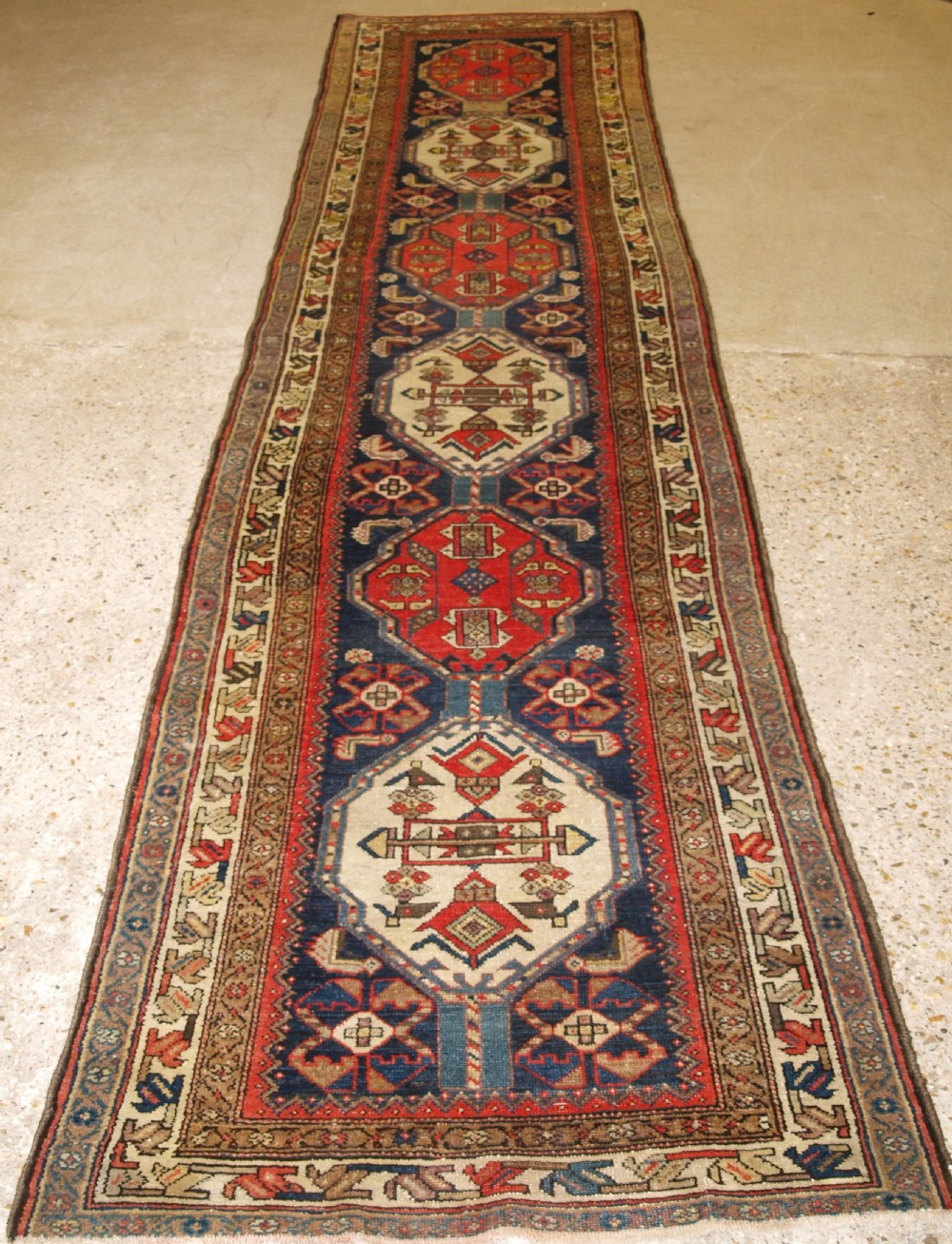 antique malayer runner with repeat medallion design circa 1900