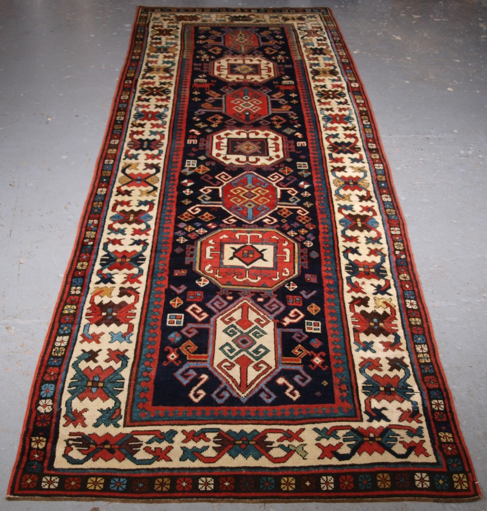 antique caucasian gendje kazak runner with medallion design circa 1890