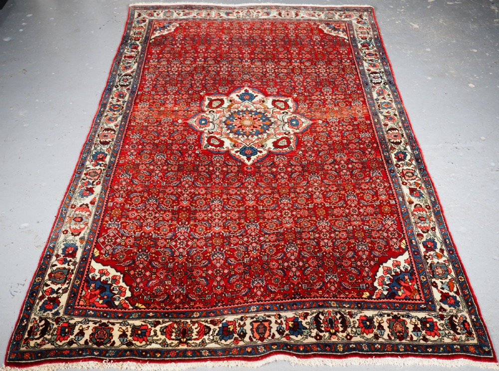 old bijar rug with small medallion firm dense weave circa 192030