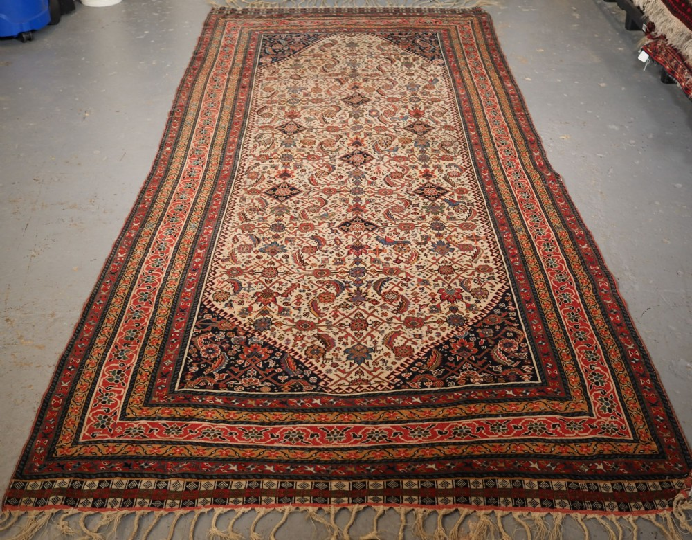 antique qashqai long rug ivory ground herati design with tibal elements circa 1870